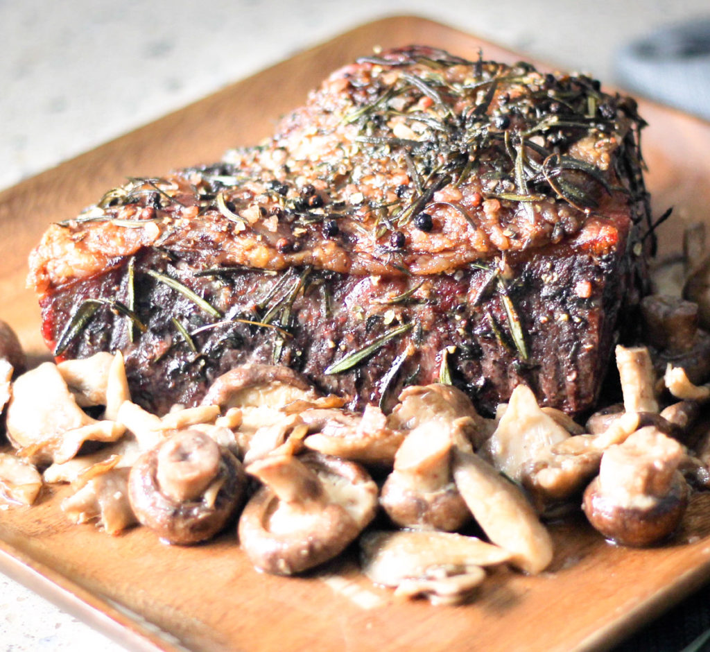 Herb Rib Roast with Garlic Mushrooms by Diverse Dinners