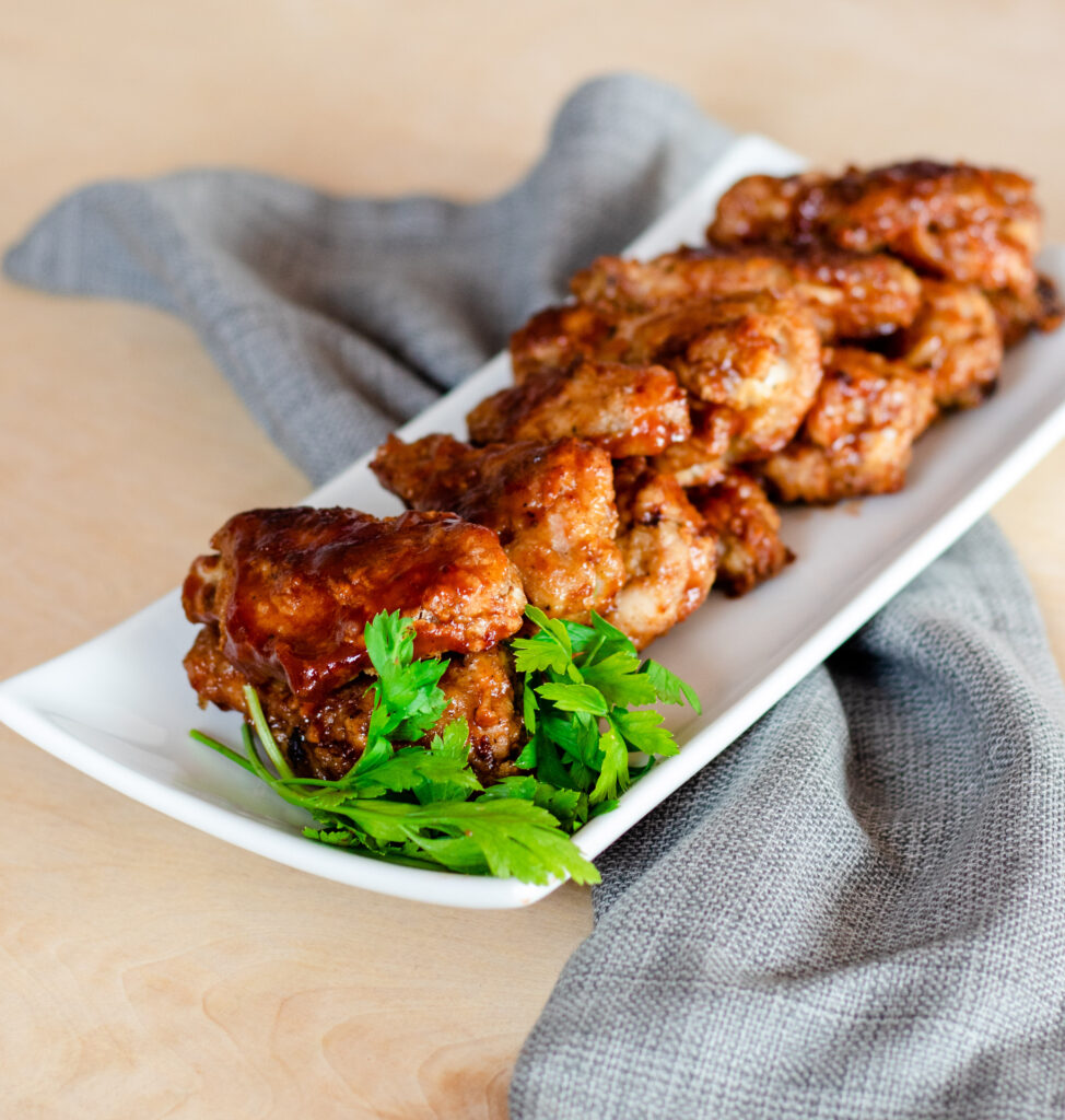 Crispy Baked Plum Glazed Chicken Wings by Diverse Dinners